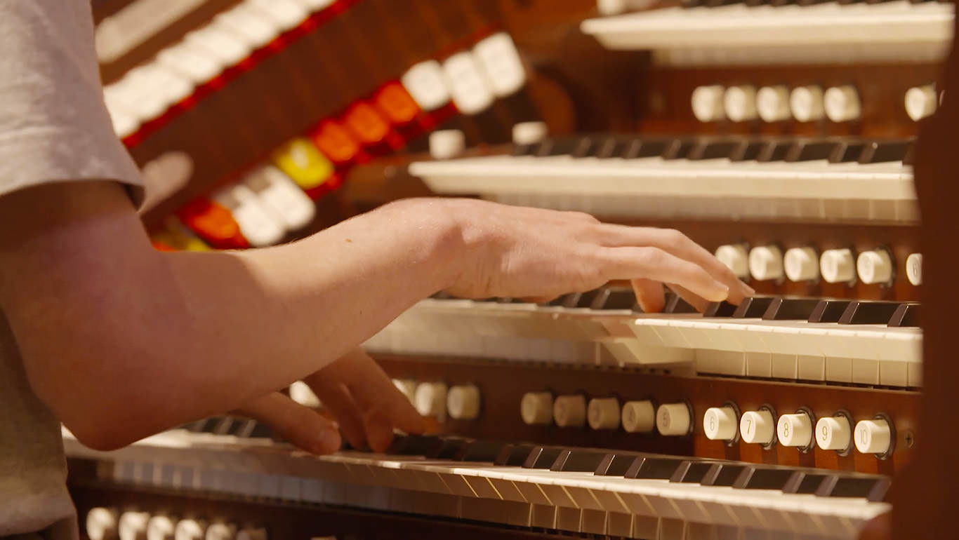 Summer Youth participant playing organ